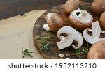 Fresh Mushrooms On Old Wooden...