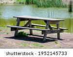Empty Wooden Picnic Table With...