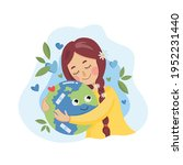 girl hugs planet earth with... | Shutterstock .eps vector #1952231440