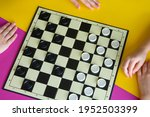 Children Play Checkers On A...
