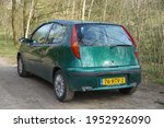 Small photo of Walbeck,Germany-April 09,2021: Green Fiat Punto parks in Walbeck. The Fiat Punto is a supermini car produced by the Italian manufacturer Fiat from 1993 to 2018.