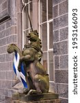 A Uniorn Statue Holding A...