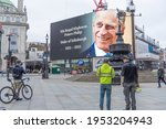 Small photo of The giant screens of Piccadilly Circus paying respect to His Royal Highness Prince Philip the Duke of Edinburgh as the announcement of his death. London - 10th April 2021