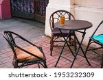 Brown Wicker Chairs And Round...