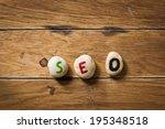 seo paint on stone on the wood | Shutterstock . vector #195348518
