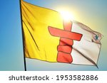 Nunavut province of Canada flag waving on the wind