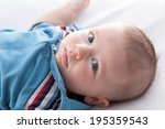 portrait of a baby boy lying on ... | Shutterstock . vector #195359543