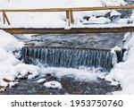 Small Wooden Bridge Over A Cold ...
