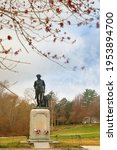 Small photo of Concord, Massachusetts - April 11, 2020: The Minute Man statue and North Bridge at Minute Man National Historic Park on a spring morning, Concord Massachusetts.