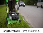 A Front View Of A Worker In...