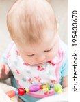cute baby girl sucking on her... | Shutterstock . vector #195433670