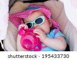 cute baby girl sucking on her... | Shutterstock . vector #195433730