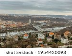 Prague,Czech republic Real estate residential concept.Czech architecture view from above.Panoramic city skyline.Barrandov Bridge over Vltava river with traffic,most frequented road.Transport in town