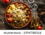 assorted pickled vegetables... | Shutterstock . vector #1954788316