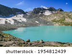 view of a mountain lake on a... | Shutterstock . vector #1954812439