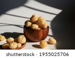 Macadamia Nuts In Wooden Bowl...