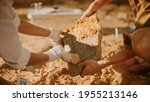 Small photo of Archeological Digging Site: Two Great Archeologists Work on Excavation Site, Carefully Cleaning, Holding Newly Discovered Ancient Civilization Cultural Artifact, Historic Clay Tablet, Fossil Remains