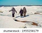 Children Walking On Icey Beach...