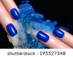 Fashionable blue nails with drops of water and crushed eyeshadow in blue silver. Manicure and makeup concept. Closeup image isolated on black - stock photo