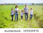 young happy family in a field | Shutterstock . vector #195535970