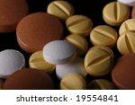 close up on mixed pills. | Shutterstock . vector #19554841