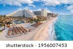 Cancun beach with resorts near blue ocean