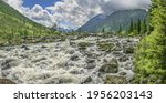 rough mountain river flows... | Shutterstock . vector #1956203143