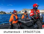Small photo of Half Moon Island, South Shetland Islands, Antarctica - 12 05 17: Female driver of a zodiac boat steering on a manoeuvre with Antarctica Seabourn cruise passengers sightseeing off the Antarctic coast