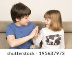 glad children clasping hands on ... | Shutterstock . vector #195637973