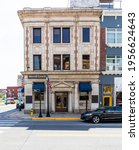 Small photo of BRISTOL, TN-VA, USA-7 APRIL 2021: Originally the First National Bank, now occupied by Merrill lynch, the marble structure sets at 500 State Street.
