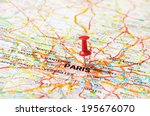 red  push pin pointing at paris ... | Shutterstock . vector #195676070