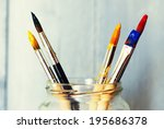 photo of paint brushes in a jar | Shutterstock . vector #195686378