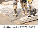 Three Construction Workers...