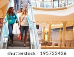 two female friends on escalator ... | Shutterstock . vector #195722426