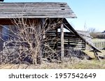 An Old Abandoned Wooden Barn...