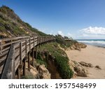 Wooden Walkway At The Base Of A ...