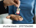 real estate house key handover... | Shutterstock . vector #1957556380