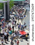 Small photo of Speedway, IN, USA - May 23, 2014: Crowds of racing fans mingle on the plaza behind the pagoda during practice on Carb Day before the 2014 Indy 500 at Indianapolis Motor Speedway.