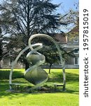 Small photo of Cambridge, United Kindom - April 21, 2019: DNA Sculpture Charles Jencks, Double Helix Aluminium in Clare College. High quality photo