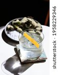 Small photo of Clea Tequila and Grapefruit Old Fashioned Cocktail with clear Ice, fresh green Almonds and Salt