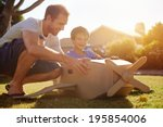 son and dad playing with toy... | Shutterstock . vector #195854006