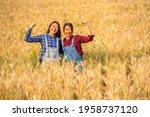 Two Asian Woman Farmer Working...