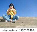 Woman Using Smartphone Outside...