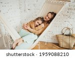 Mom With Daughter Hugging In...
