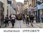 People Shop On The High Street...