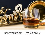 saxophone and whiskey on a... | Shutterstock . vector #195952619