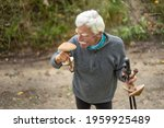 A Happy Senior Man Collecting...