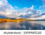 sunset on the lake. dramatic... | Shutterstock . vector #1959985120