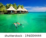 couple snorkling in tropical... | Shutterstock . vector #196004444