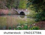 A Stone Bridge Spanning A Pond...